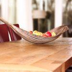 Op maat gemaakte massief eiken eetkamertafel met prachtige zwaluwstaartverbindingen. De tafel heeft een stoer onderstel met een horizontale voetenbalk.